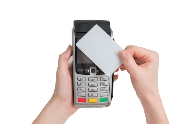 Payment with nfc tecnology credit card on pos terminal in woman hands