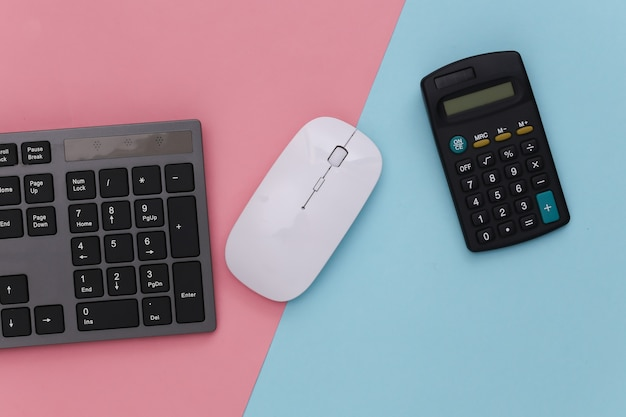 Pc keyboard with calculator on pink blue pastel. online business