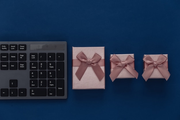 Pc keyboard with gift boxes on a classic blue