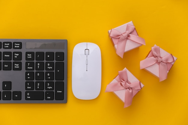 Pc keyboard with gift boxes on yellow