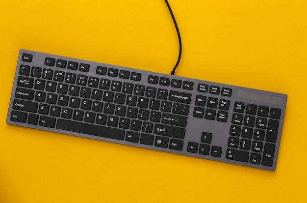 Pc keyboard on yellow