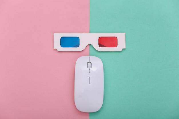 Компьютерная мышь с анаглифическими очками 3d на синем розовом фоне пастельных тонов. развлечение. вид сверху