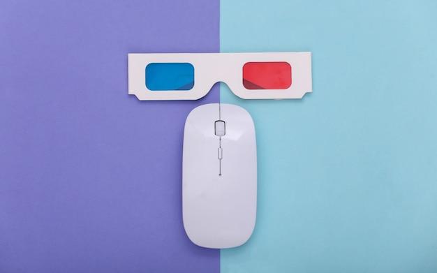 Компьютерная мышь с анаглифическими очками 3d на синем фиолетовом пастельном фоне. развлечение. вид сверху