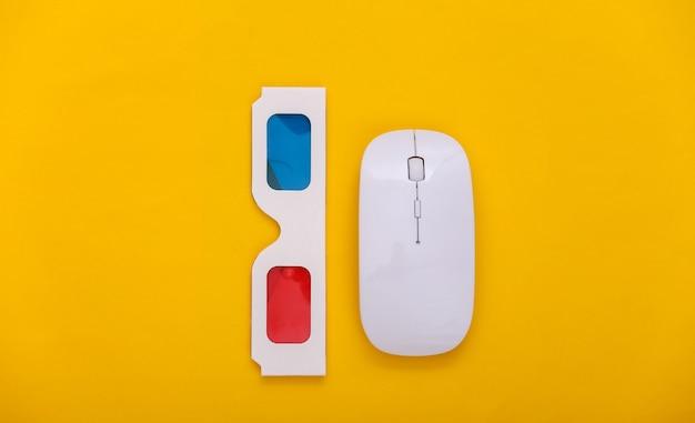 Мышь пк с очками анаглифа 3d на желтом фоне. развлечение. вид сверху