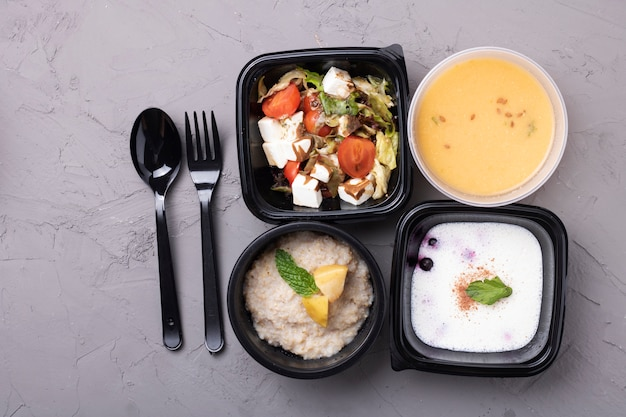 Pea soup, porridge, salad and fork with spoon