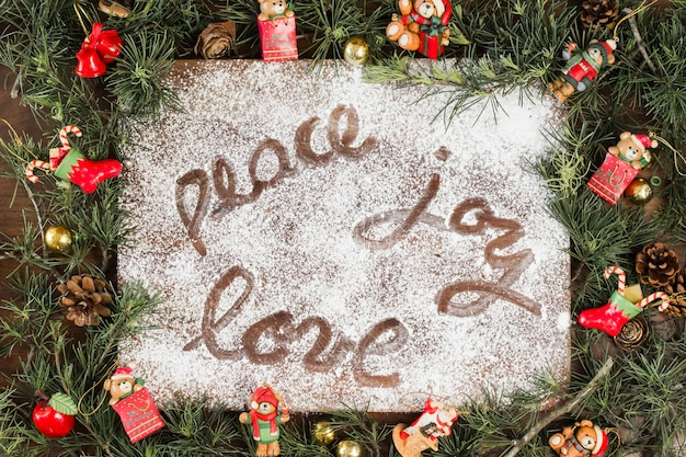 Peace joy love inscription on white sugar powder