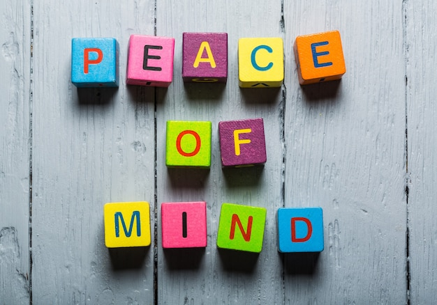 Peace of mind wooden colorful box on wooden desk