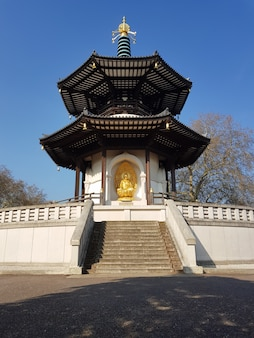 Peace pagoda temple in battersea park by the river thames, london, uk