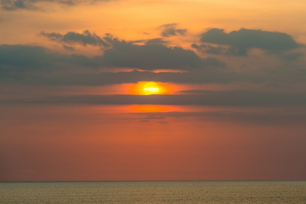Peaceful atmosphere during sunrise or sunset over the ocean with blank space.
