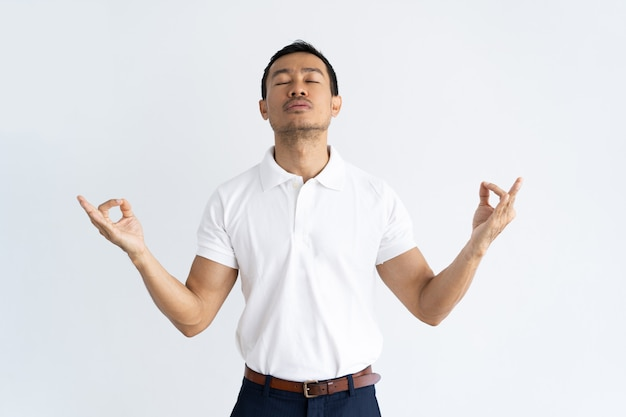 Peaceful guy holding zen position