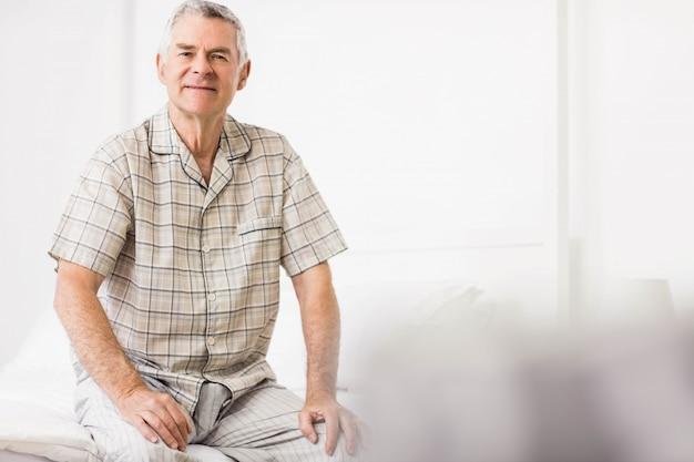 Peaceful senior man smiling at home