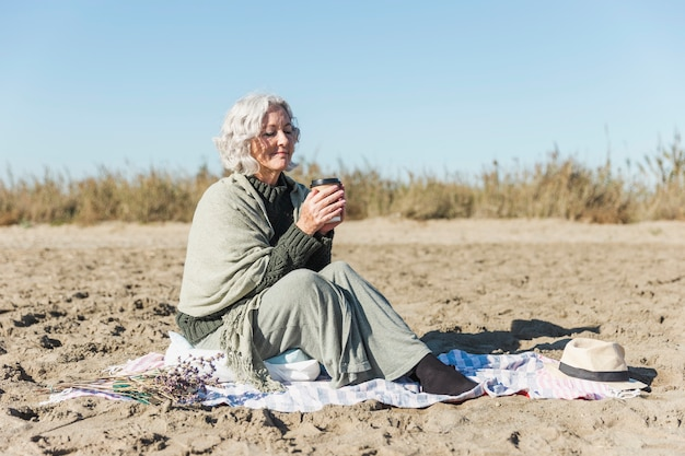 Peaceful senior woman holding coffee