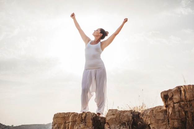 Peaceful woman stretching arms