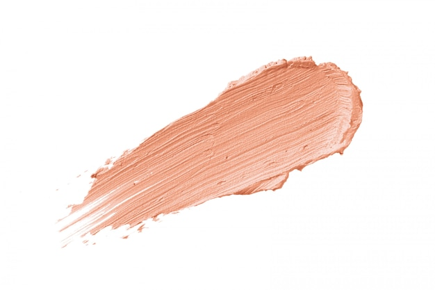 Peach color correcting concealer stroke isolated
