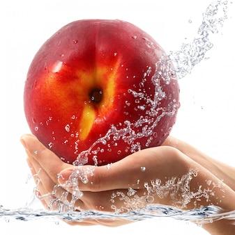 Peach falling in water