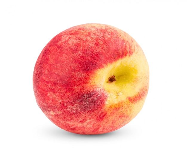 白い壁に桃の果実
