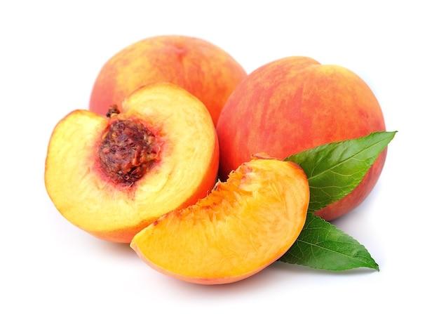 Плоды персика на белом