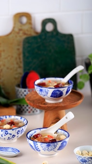 Peach gum collagen dessert is a chinese traditional refreshment beverages. it is contains bird nest, red dates, snow fungus, goji berry. selected focus