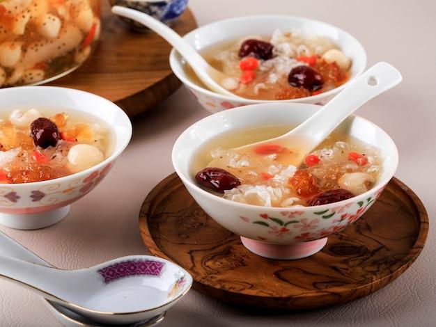 Peach gum triple collagen dessert, chinese traditional refreshment beverages contains peach gum, bird nest, red dates, snow fungus, goji berry, pandan leaves, and rock sugar.