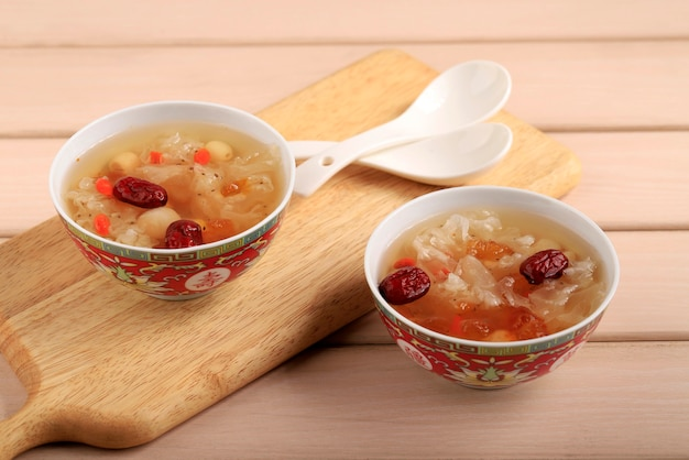 Peach gum triple collagen dessert (tao jiao), chinese traditional refreshment beverages contains peach gum, bird nest, red dates, snow fungus, goji berry, and rock sugar. copy space for text