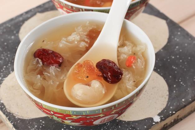 Peach gum triple collagen dessert (tao jiao), chinese traditional refreshment beverages contains peach gum, bird nest, red dates, snow fungus, goji berry, and rock sugar