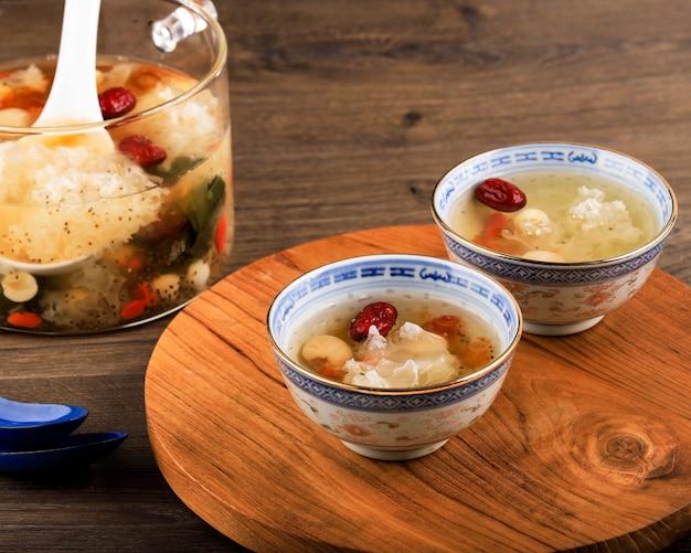 Peach gum triple collagen dessert (tao jiao), chinese traditional refreshment beverages contains peach gum, bird nest, red dates, snow fungus, goji berry, and rock sugar.