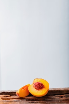 Peach in halves with bone. ripe juicy peaches. modern still life on white background.