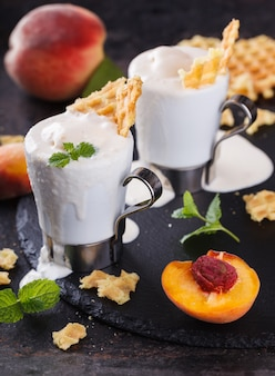 Peach  ice cream with mint. summer sweet dessert.