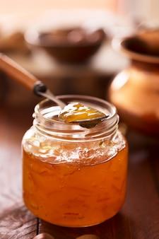 Peach jam in a transparent jar