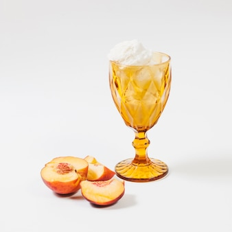 Peach near cup of ice-cream