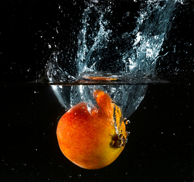Peach splashes in the water