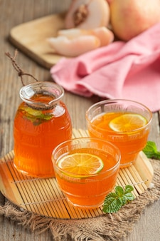 Peach tea peach food and beverage products food nutrition concept.