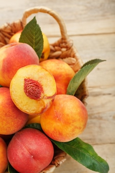 Peaches in a basket on a wooden