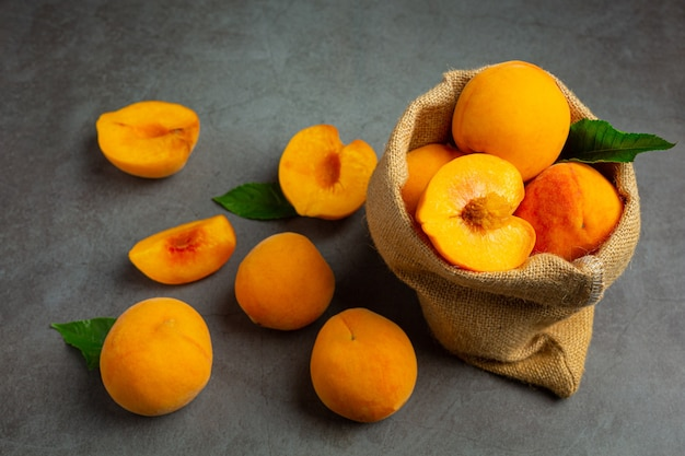 Peaches on a black background