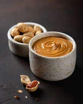 Peanut butter in a ceramic bowl on the table