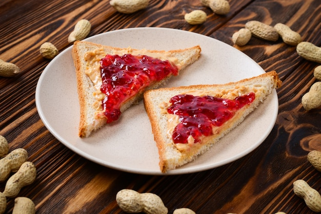Peanut butter and jelly sandwich on wooden background