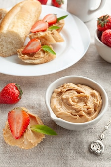 Peanut butter sandwich. decorated with mint and strawberries