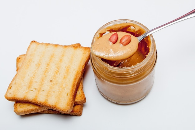 Peanut butter sandwiches or toasts on white.