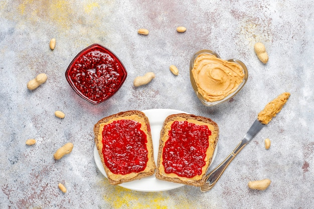 Peanut butter sandwiches or toasts with raspberry jam.
