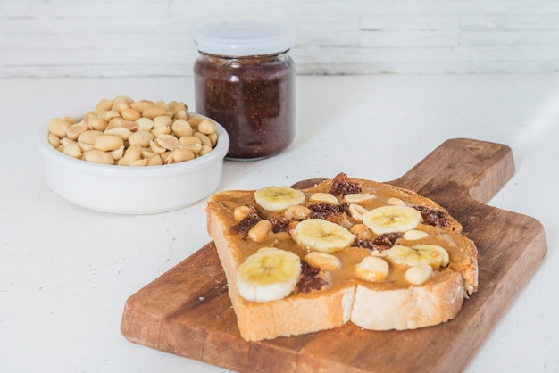 Peanut butter with bread and raspberry marmalade