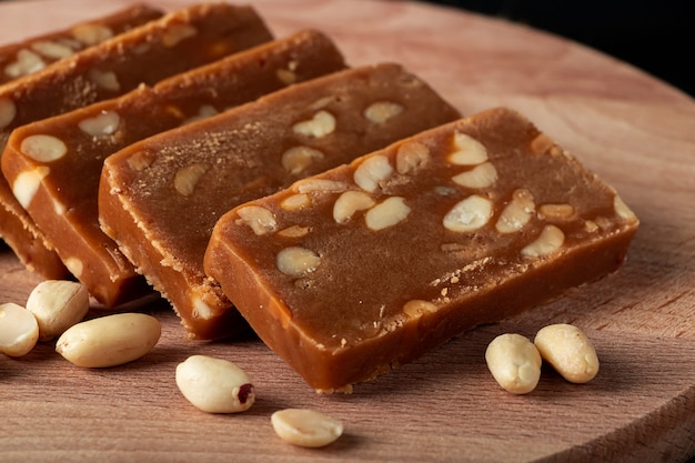 Peanut home toffee on a wooden board. slices of eastern sweets with nuts.