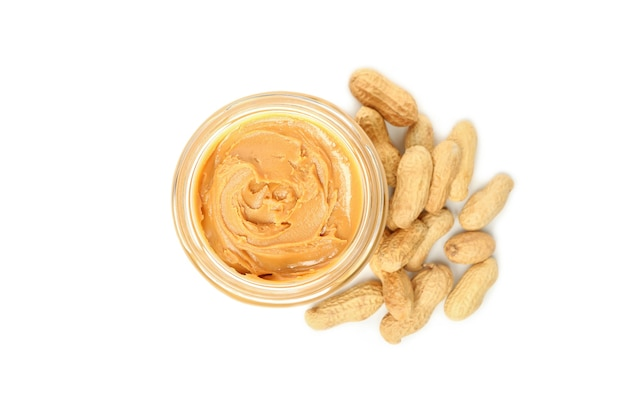 Peanut and jar with peanut butter isolated