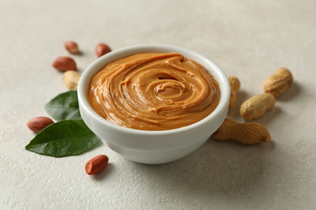 Peanut and leaves and bowl with peanut butter isolated