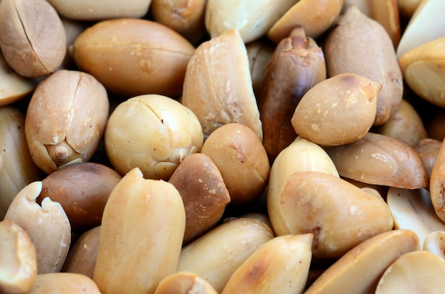 Peanut. a lot of small yellow nuts without peel. background texture