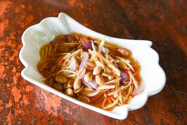 Peanut salad with mango, spicy salad for sauce food