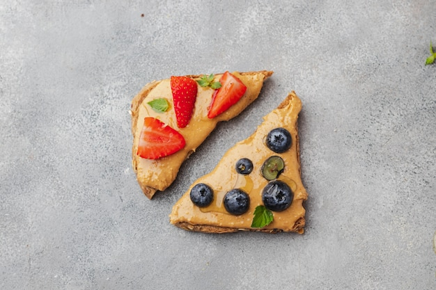 Peanut sandwiches with honey, mint, blueberry and strawberry