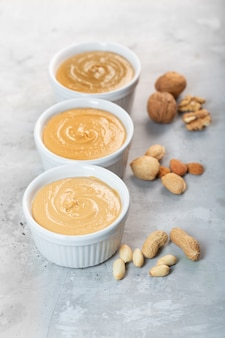Peanut, walnut and almond butter on the gray table