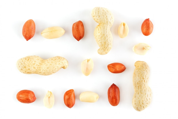Peanuts isolated on white background. peeled peel and scarlup.