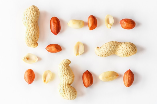 Peanuts isolated on white . peeled peel and scarlup.