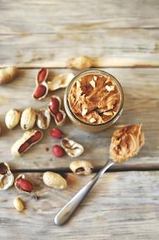 Peanuts. a jar of peanut butter.